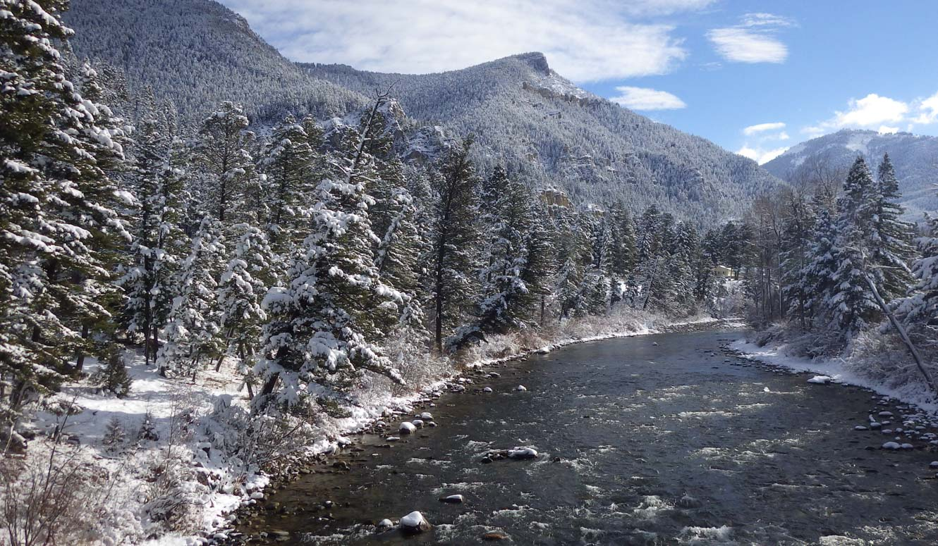River flowing through snowy mountains.