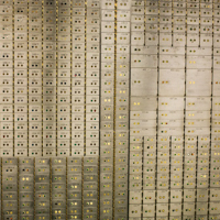 Wall of safe deposit boxes.