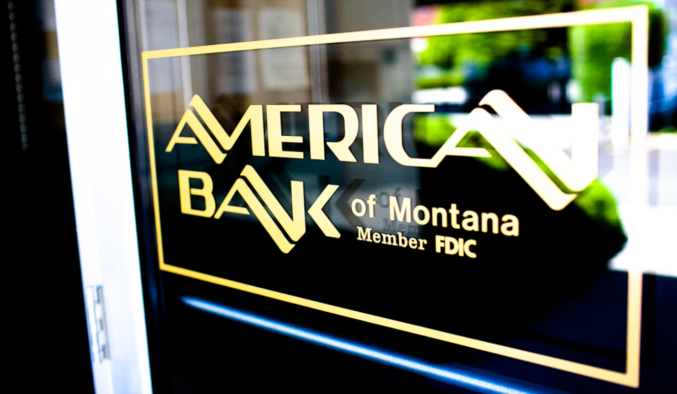 American Bank logo decal on a glass door