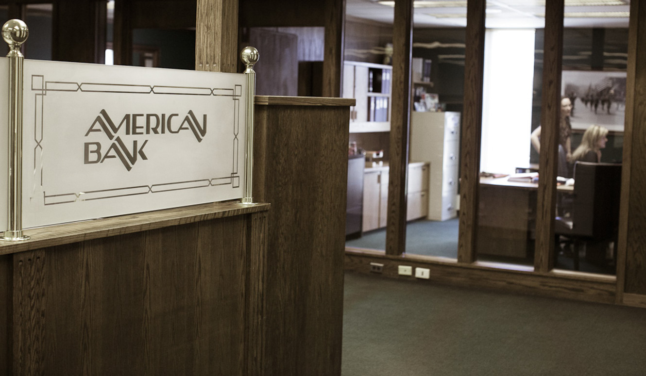 American Bank logo at a bank teller station
